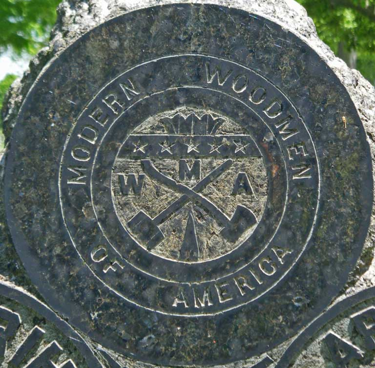 Close-up of Modern Woodmen of America logo, Rihl tombstone, Forest Cemetery, Circleville, Ohio. Photo by Amy Crow, 10 May 2009; all rights reserved.